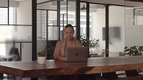 woman working on macbook air in modern office